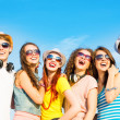 Group of young people wearing sunglasses and hat — Stock Photo #30131763