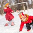 Children in Winter Park playing snowballs — Stock Photo #30131853