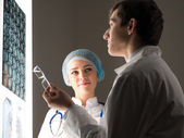 Medical colleagues confer near the x-ray image — Stock Photo