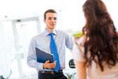 Sales manager at a showroom car — Stock Photo