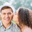 Girl kissing a man on the cheek — Stock Photo