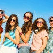 Stock Photo: Group of young people wearing sunglasses and hat