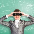 Business woman looking through binoculars — Stock Photo