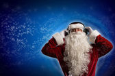 Santa Claus is listening to music — Stock Photo