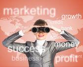Business woman looking through binoculars — Stock Photo