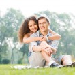 Couple lying on the grass in the summer park — Stock Photo