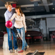 Stock Photo: Young couple plays bowling