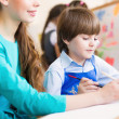 Teacher and student in the classroom — Stock Photo #32747689