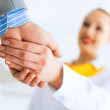 Business woman shaking hands with a client — Stock Photo