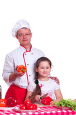 Father and daughter cooking together — Stock Photo