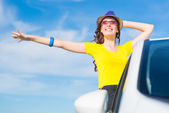 Young woman got out of car window — Stock Photo