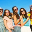 Young people wearing sunglasses and hat — Stock Photo #33909967