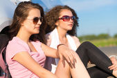 Two attractive young women wearing sunglasses — Stock Photo