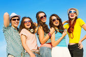 Young people wearing sunglasses and hat — Stock Photo