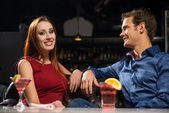 Couple talking in a nightclub — Stock Photo