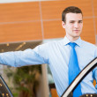 Dealer stands near a car — Stock Photo