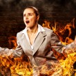 Violent woman, surrounded by smoke — Stock Photo #34988077