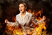 Violent woman, surrounded by smoke — Stock Photo