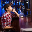 Young man at the bar — Stock Photo