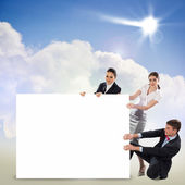 People holding a blank banner — Stock Photo