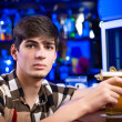 Portrait of a young man at the bar — Stock Photo