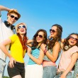 Group of young people wearing sunglasses and hat — Stock Photo #35780657