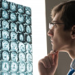 Stock Photo: Male doctor looking at x-ray image