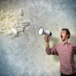 Young man shouting using megaphone — Stock Photo