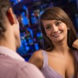 Portrait of a nice woman at the bar — Stockfoto