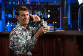 Young man at the bar — Foto de Stock
