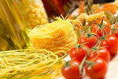 Cherry tomatoes and pasta — Stock Photo