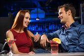 Young couple talking in a nightclub — Stock Photo