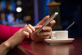 Female hands holding a cell phone — Stock Photo