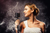 Blonde woman singer — Stock Photo