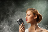 Woman singer — Stock Photo