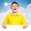 Boy holding a white banner — Stock Photo