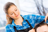 Close portrait of a woman hairdresser — Stockfoto