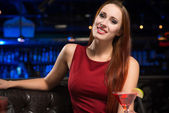 Portrait of an attractive woman in a nightclub — Stock Photo