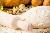 Flour, eggs, white bread, wheat ears — Stock Photo