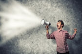 Man yells into a megaphone — Stock Photo