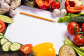 Vegetables tiled around a sheet of paper — Stock Photo