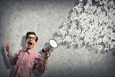 Man yells into a megaphone — Stock Photo
