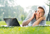 Young man with a cell phone — Stock Photo