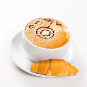 Large cup of coffee and croissants — Stock Photo