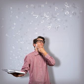 Young scientist holding a book — Stock Photo