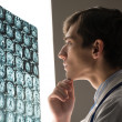 Doctor looking at the x-ray image — Stock Photo