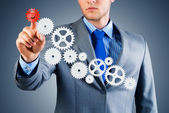 Businessman touch the mechanism — Stockfoto