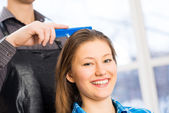 Male hairdresser puts woman's hair — Stock Photo