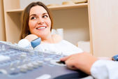 Pregnant woman on reception at the doctor — Stock Photo
