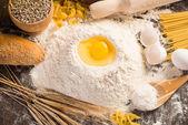 Flour, eggs, wheat still-life — Stock Photo